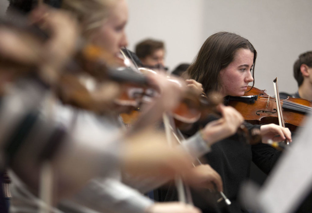 Members of the Lawrence Symphony Orchestra rehearse in Shattuck Hall.