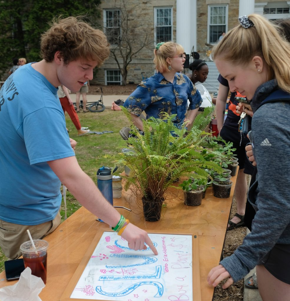 Students supporting the SLUG garden sell plants during the 2019 Earth Day Gala.