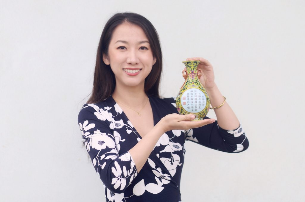Yexue Li poses with the tiny vase.