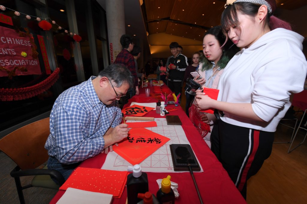 A table at last year's Lunar New Year draws visitors.