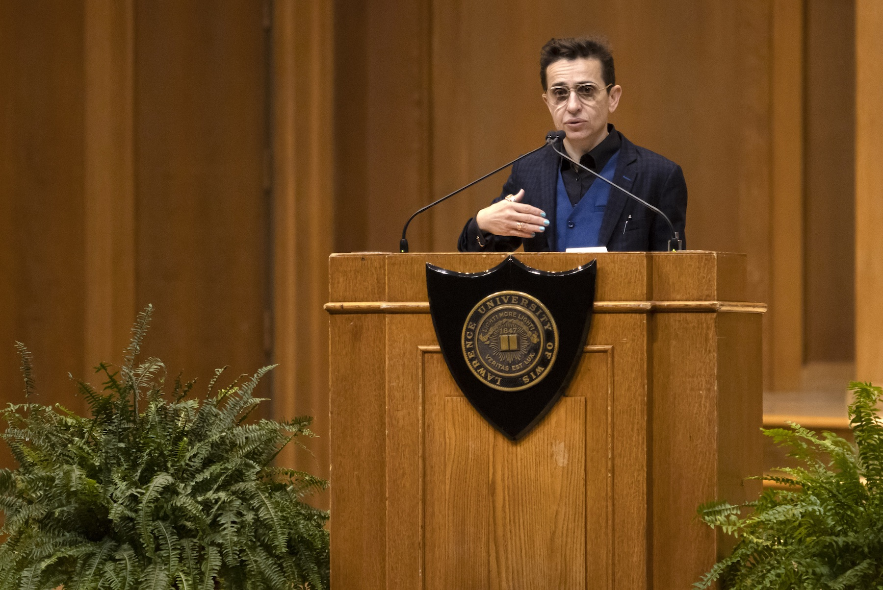 Masha Gessen talks at the podium on the stage of Memorial Chapel during Thursday's convocation.