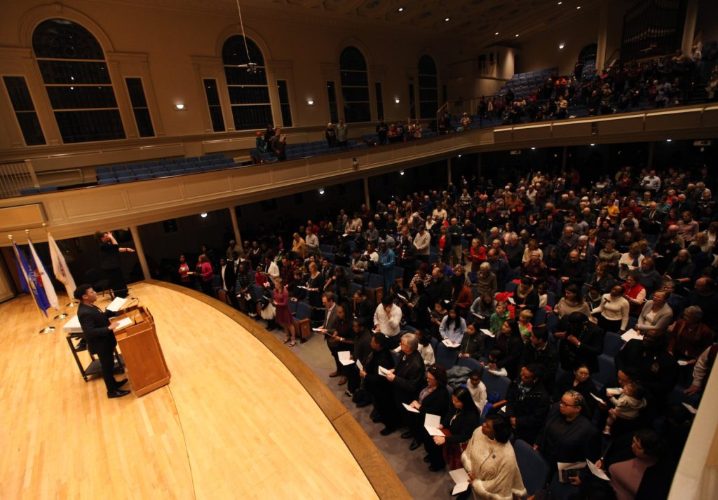 Memorial Chapel is mostly full as Lawrence student Kyree Allen sings during Monday's MLK event.
