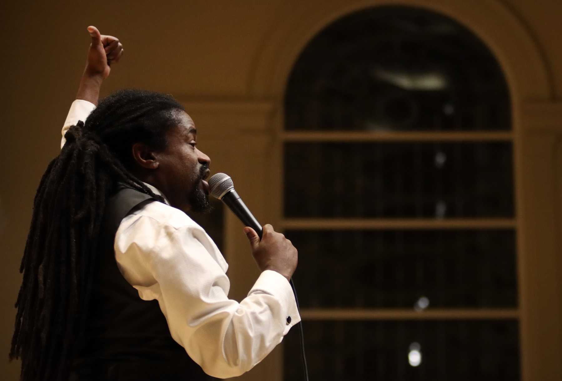 Rev. Sekou leads the audience in song during Monday's MLK Celebration at Memorial Chapel.