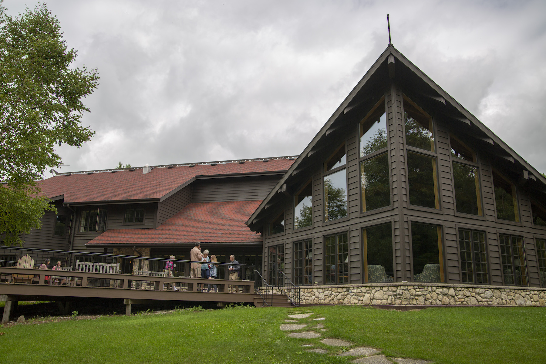 Summer seminar participants gather on the deck of the lodge at Bjorklunden during the summer of 2019.
