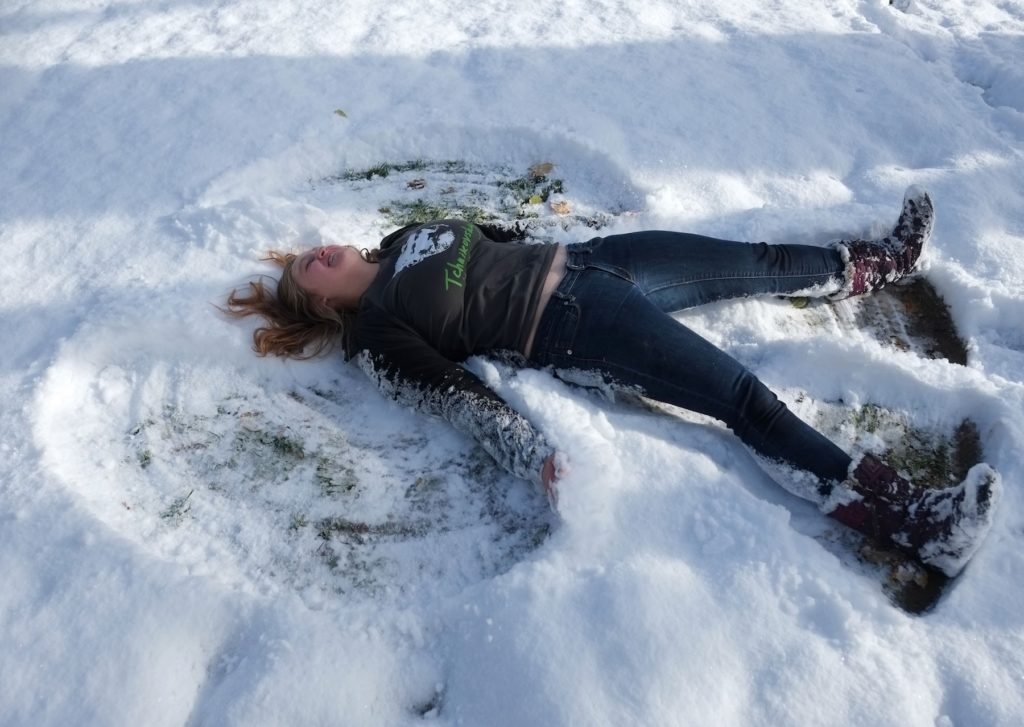 Shae Erlandson makes a snow angel on Main Hall Green.