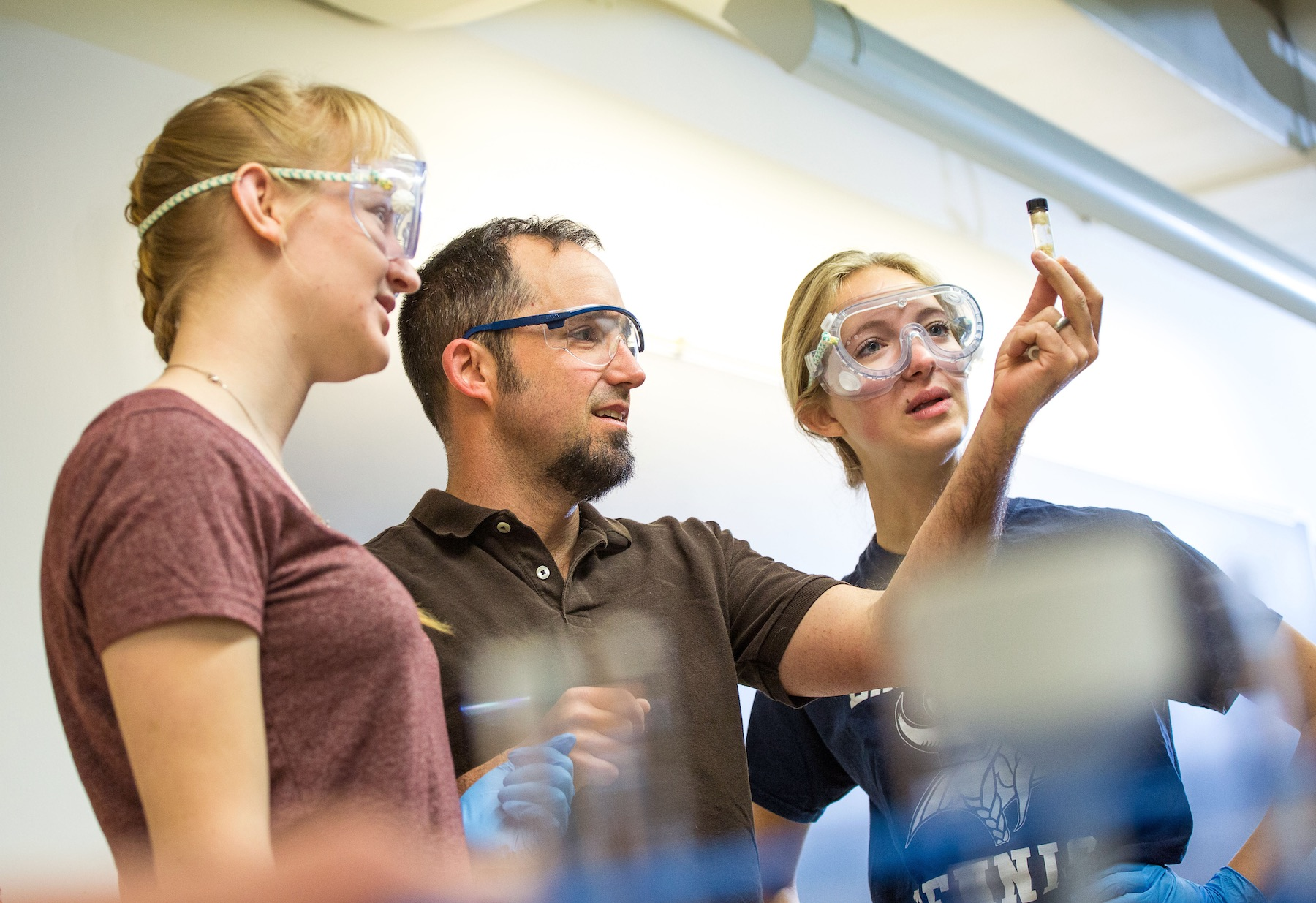 Students work with chemistry professor Stefan Gebbert in class.