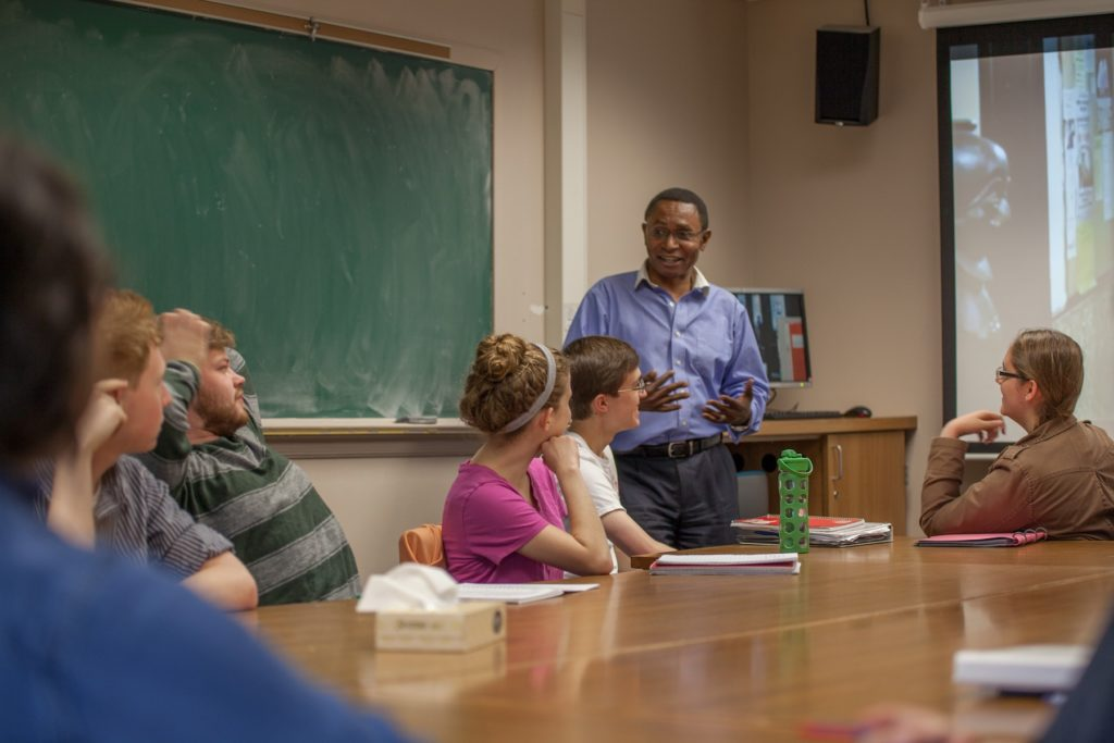 Lifongo Vetinde talks with students in a class at Lawrence.