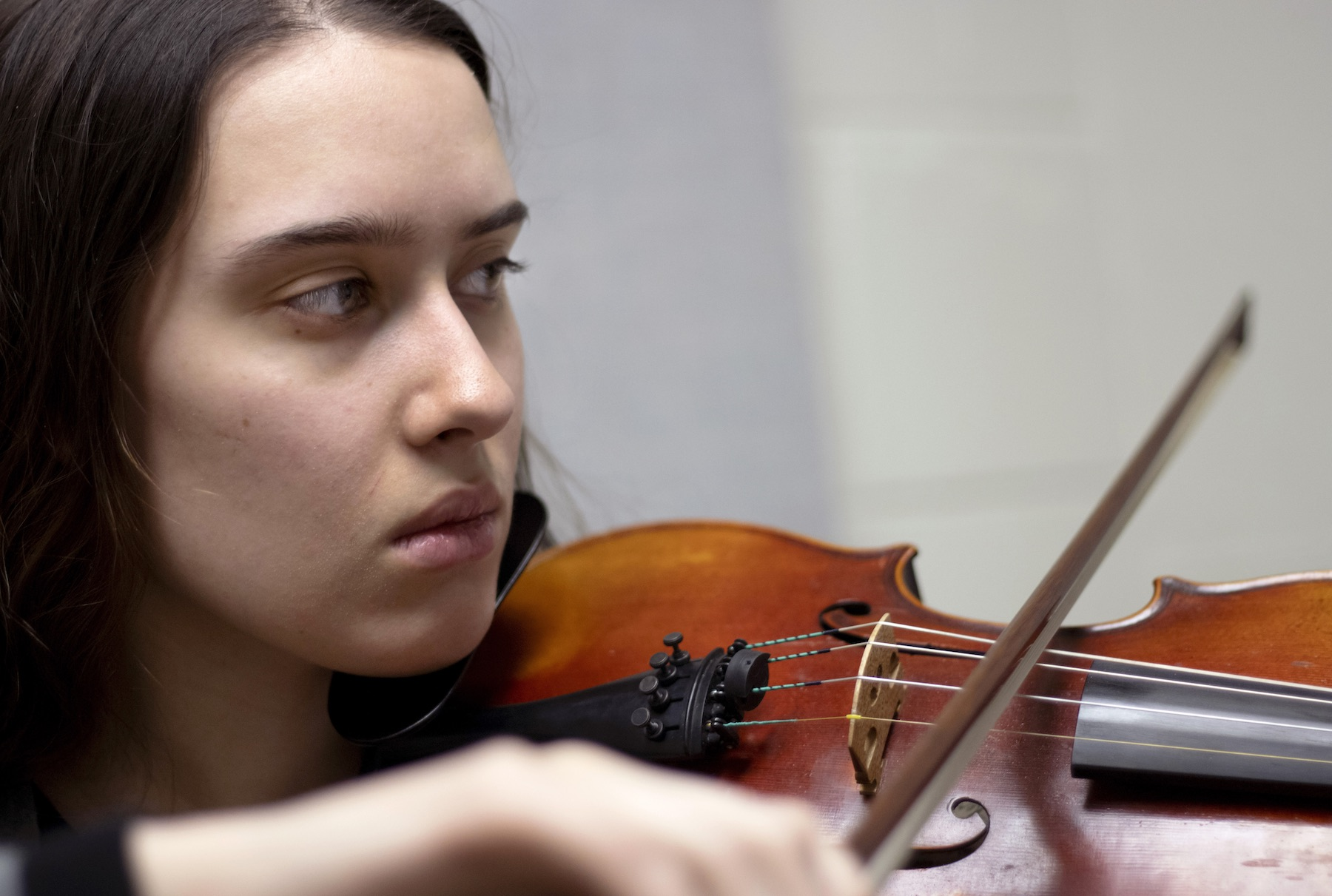 Rehanna Rexroat '20 plays the violin during a recent rehearsal session in Shattuck Hall.