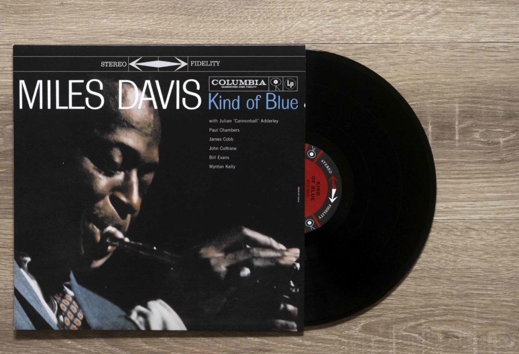 A vinyl record: Kind of Blue by Miles Davis.