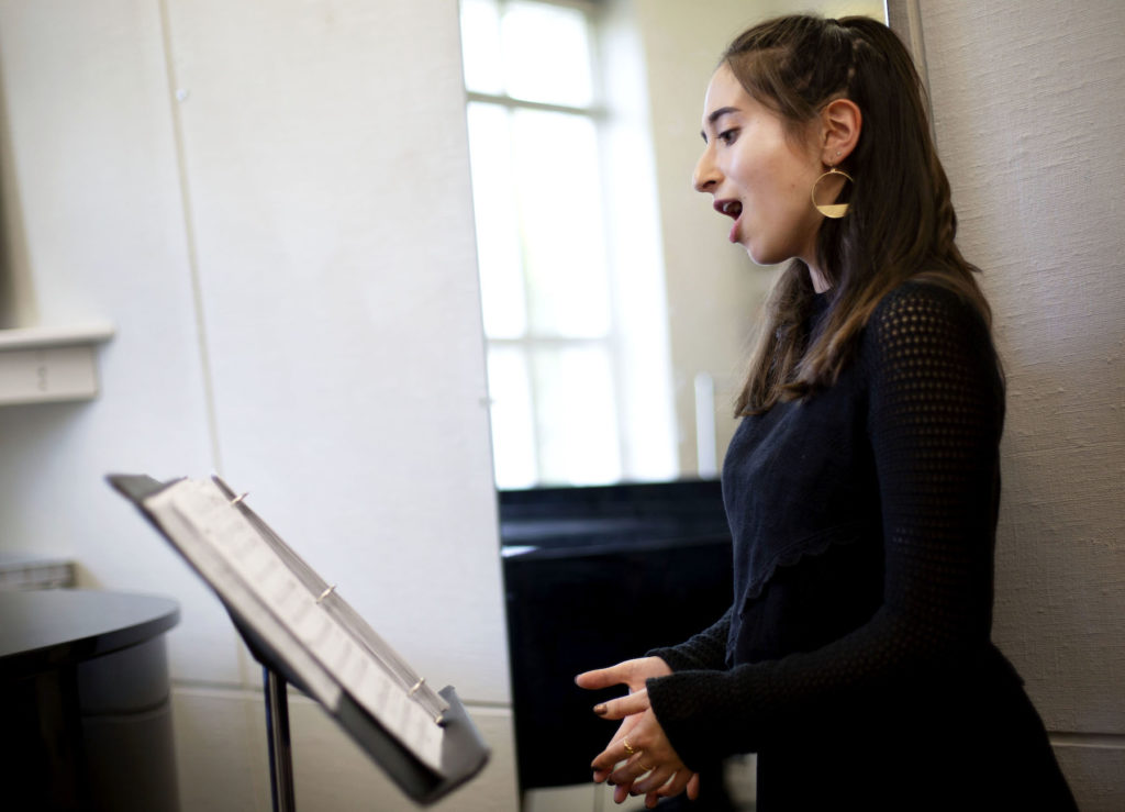 Emily Austin '21 works on her vocals in the voice studio in the Lawrence Conservatory.